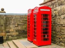 British Red Telephone Booths. In the ancient Edinburgh Castle. Edinburgh, Scotland, UK Stock Image