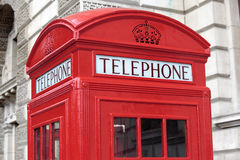 British red telephone box with building in background, London, UK Royalty Free Stock Image