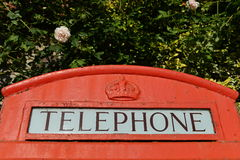 British Red Telephone Box. Close-up Detail of the Word `Telephone` on a Traditional British Red Phone Box Seen on a London Street Stock Images