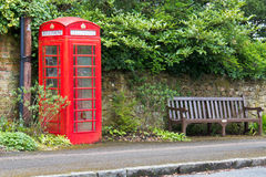 British red telephone box in rural England Royalty Free Stock Photography