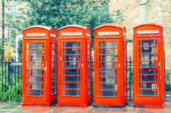 British red telephone boxes vintage filter applied Stock Images