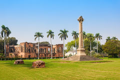 The British Residency. Museum and the High cross Sir Henry Lawrence Memorial at the British Residency in Lucknow, India Stock Photo