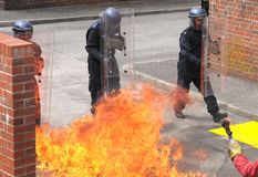 British riot police. Police undertake training against public order disturbance and the use of petrol bombs. Training is realistic and vigorous. Hampshire Stock Image