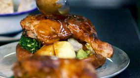 British roast with sauce. A plate of traditional British roast being poured with sauce
