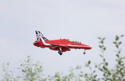British Royal Air Force Red Arrows. Red Arrow number 8 coming in to land after performing over the skies of Farnborough during the Farnborough Airshow 2014 held Royalty Free Stock Images