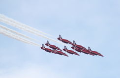 British Royal Air Force Red Arrows Display Team. Red Arrows in formation over the skies of Farnborough during the Farnborough Airshow 2014 held in Farnborough Stock Photography