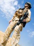 British Royal Commando. In desert uniform holding his rifle Stock Photography