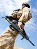 British Royal Commando. In desert uniform holding his rifle Stock Photos