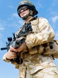 British Royal Commando. In desert uniform holding his rifle Stock Images