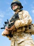 British Royal Commando. In desert uniform holding his rifle Stock Photo