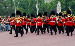 British Royal Guard of Honor. In front of Buckingham Palace, The British Royal Guard of Honor walk around the street stock photos