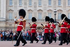 British Royal guards, the Military Band perform the Changing of the Guard in Buckingham Palace Royalty Free Stock Photo