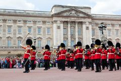 British Royal guards, the Military Band perform the Changing of the Guard in Buckingham Palace Royalty Free Stock Photography