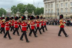 British Royal guards perform the Changing of the Guard in Buckingham Palace, London, England, Gre. LONDON, ENGLAND - JUNE 17, 2016: British Royal guards perform royalty free stock photography