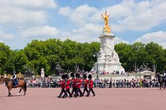British Royal guards perform the Changing of the Guard in Buckingham Palace Stock Photography