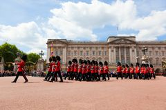 British Royal guards perform the Changing of the Guard in Buckingham Palace Royalty Free Stock Photography