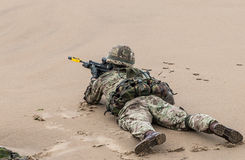 British Royal Marine Commando. S perform a beach assault demonstration for the public during the 2015 Sunderland Airshow Royalty Free Stock Photos