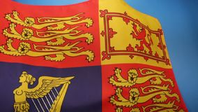 British Royal Standard - United Kingdom. The Royal Standard of the United Kingdom is the flag used by Queen Elizabeth II in her capacity as Sovereign of the stock footage