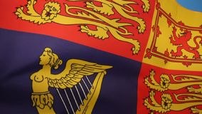 British Royal Standard - United Kingdom. The Royal Standard of the United Kingdom is the flag used by Queen Elizabeth II in her capacity as Sovereign of the stock video