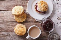 British scones with jam and tea close-up. Horizontal top view Royalty Free Stock Image