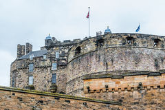 British and Scottish flags over Edinburgh Castle, Scotland. EDINBURGH, SCOTLAND - SEPTEMBER 14, 2014: British and Scottish flags waving in the wind on Edinburgh Royalty Free Stock Photography