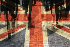 British shoppers. Conceptual image of shoppers overlaid onto UK flag Royalty Free Stock Photography