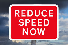 British signpost REDUCE SPEED NOW Royalty Free Stock Image