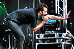 British singer Tom Smith from Editors. MOSCOW, RUSSIA - JULY 31, 2010: British singer Tom  Smith from Editors during performance at Moscow rock festival in Stock Photography
