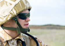 British soldier. With the reflection of UK flag in glasses looking forward Royalty Free Stock Photography