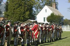 British soldiers. Toast to the King of England in front of the Digges House, built in 1775 in Yorktown, Virginia. First owner Dudley Digges' house now resides Royalty Free Stock Images