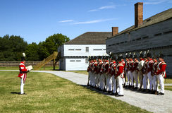 British soldiers in Fort George. Staff and volunteers at Fort George, Niagara-at-at-the-lakes, Canada dressed in period uniforms re-enact life of a british Stock Photo