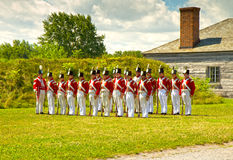 British soldiers in Fort George. Staff and volunteers at Fort George, Niagara-at-at-the-lakes, Canada dressed in period uniforms re-enact life of a british Royalty Free Stock Photos
