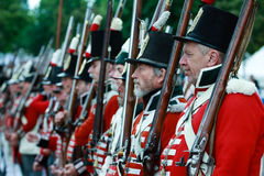 British soldiers in reenactment. British Soldiers at the Battle of Stoney Creek, War of 1812 re-enactment. http://www.battlefieldhouse.ca/reenactment.asp Stock Photos