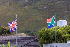 British and South African flags waving near the building in Hermanus royalty free stock photography