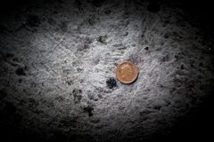 British sterling one pence or penny on a concrete floor bringing Stock Photo