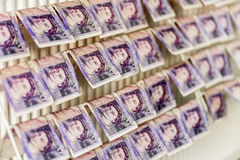 British Sterling Pounds Notes On Clothes Dryer. Money Laundering Concept Stock Photography