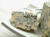 British stilton blue cheese. On platter with knife Royalty Free Stock Image