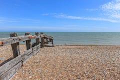 British stoney beach and wooden groyne. Stock Photography