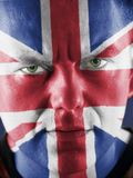 British supporter. Closeup of young UK supporter  face with painted national flag colors Royalty Free Stock Image