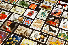 British symbols on stamps. The queen, Henry VIII, Horatio Nelson, the flag, the London bridge and other british symbols on the postage stamps Stock Image