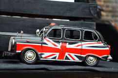 British taxi with flag in London Stock Photo