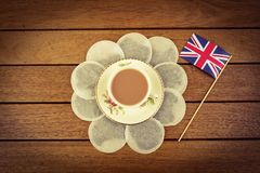 British Tea. A cup of tea surrounded by teabags with a union jack flag Royalty Free Stock Image