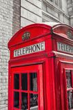 British Telephone Booth in London street, uk. Traditional red phone booth closeup at london in black and white colors. ideal for websites and magazines layouts Royalty Free Stock Images