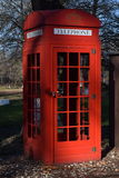 British telephone booth. British telephone booth at Mesopotamia Kastoria Greece little forest. Nice colors Royalty Free Stock Images
