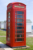 British Telephone Box. A British telephone box located at an English seaside resort. Such telephone boxes are increasingly rare to find Stock Images