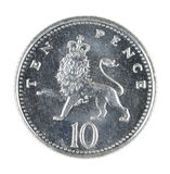 British Ten Pence Coin Isolated on White. British currency. Ten 10 10p Pence coin featuring a crowned Lion. Isolated on a white background. Money