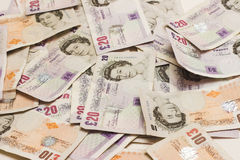 British tens and twenties. A pile of british money Stock Image