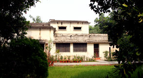 British time houses in IIT Roorkee campus with large rooms and well ventilation. ROORKEE, INDIA - JULY 03: Old British time houses for faculty residence in the Royalty Free Stock Photography