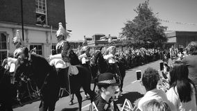British traditional Royal Guards on horses black and white. WINDSOR, UNITED KINGDOM - MAY 19, 2018: Crowd admiring the Royal Guards on horses after newlywed stock footage