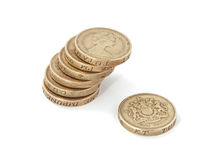 British, UK, two pound coins. British, UK, pound coins on a plain white background Royalty Free Stock Photo